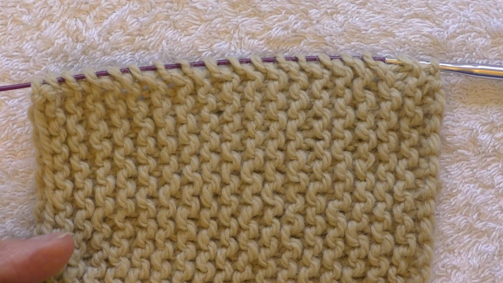 All the bumps along the edge have been placed on the left hand needle (shown on the cable so the stitches are easier to distinguish).