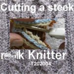 Title screen for T202004 - Cutting a steek. Shows a steek with an even number of stitches being cut with a pair of scissors.