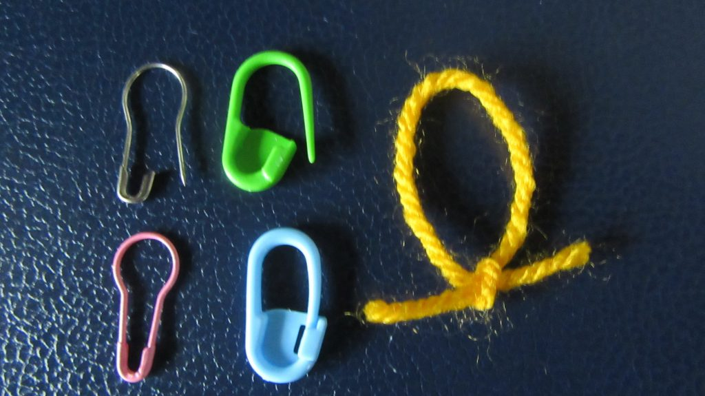 Example metal, plastic and yarn removable stitch markers.